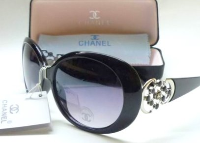 4834b89af90 This is an authentic Chanel Ladies Sunglasses. Has black frame and light  black lenses. Chanel logo engraved on end of each arm.